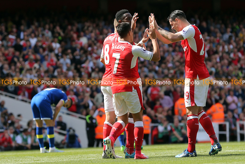 Alexis Sanchez of Arsenal is congratulated after scoring the second goal during Arsenal vs Everton, Premier League Football at the Emirates Stadium on 21st May 2017