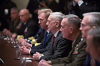 Senior military leadership, including Secretary of Defense James Mattis (center) participate in a meeting with U.S. President Donald J. Trump at The White House in Washington, DC, March 9, 2018.<br /> <br /> CAP/MPI/RS<br /> &copy;RS/MPI/Capital Pictures