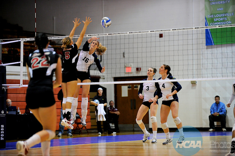 04 DEC 2010:  Emily Palkert (16) of Concordia St. Paul spikes the ball past Kaleigh Cunningham (5) of Tampa during the Division II Women's Volleyball Championship held at Knights Hall on the Bellarmine campus in Louisville, KY.  Josh Duplechian/NCAA Photos