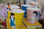 "Different products of ""Cup no Fuchiko"" on display at the office of Kitan Club CO. LTD on August 19, 2014 in Tokyo, Japan. These mini figures are popular amongst young Japanese women who often use them when composing pictures of their lunch. The name Cup no Fuchiko translates to  or ""office lady, or OL, on the side of a cup"" and the figures are sold as drink ornaments. Made by  Kitan Club CO. LTD Cup no Fuchiko was created by the manga artist Katsuki Tanaka. There are currently 21 models of Cup no Fuchiko and Kitan Club has also made capsule toys from famous characters such as Street Fighter II, Moomin, Hello Kitty. (Photo by Rodrigo Reyes Marin/AFLO)"
