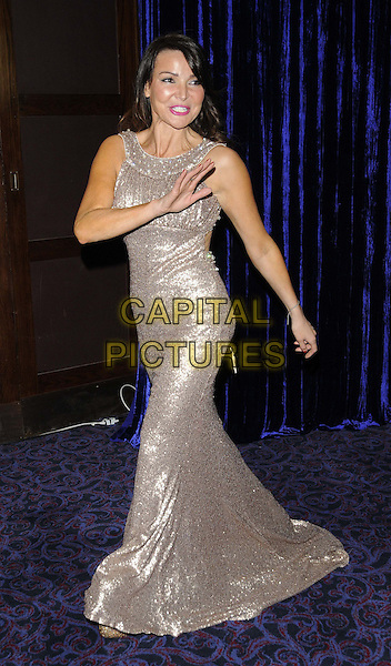 Lizzie Cundy.attended the Retail Trust London Ball, Grosvenor House Hotel, Park Lane, London, England..January 28th, 2013.full length silver sparkly sleeveless dress hand arm waving .CAP/CAN.©Can Nguyen/Capital Pictures.