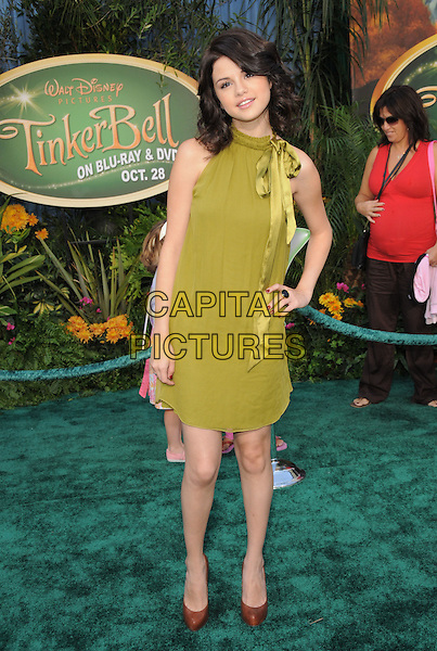 "SELENA GOMEZ .at Disney's ""Tinker Bell"" DVD & Blu-ray Disc Premiere held at The El Capitan Theatre in Hollywood, California, USA, October 19th 2008.                                                                     .full length green dress bow brown shoes heels hand on hip.CAP/DVS.©Debbie VanStory/Capital Pictures"