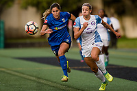 Seattle, WA - Sunday, May 21, 2017: Alanna Kennedy and Katlyn Johnson during a regular season National Women's Soccer League (NWSL) match between the Seattle Reign FC and the Orlando Pride at Memorial Stadium.