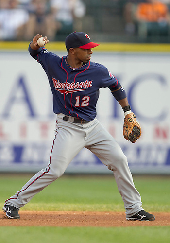 May 31, 2011:  Minnesota Twins second baseman Alexi Casilla (#12) throws the ball in game action during MLB game between the Minnesota Twins and the Detroit Tigers at Comerica Park in Detroit, Michigan.  The Tigers defeated the Twins 8-7.