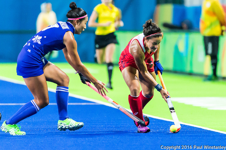 Melissa Gonzalez #5 of United States tries to pass the ball past Aki Mitsuhashi #7 of Japan during USA vs Japan in a Pool B game at the Rio 2016 Olympics at the Olympic Hockey Centre in Rio de Janeiro, Brazil.