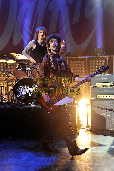 The Darkness - Justin Hawkins & Frankie Poullain.Performing live at Shepherd's Bush Empire, London, England..June 8th 2011.stage concert live gig performance music full length tiger animal print bass trousers  tattoos moustache mustache facial hair guitar drums.CAP/MAR.© Martin Harris/Capital Pictures.