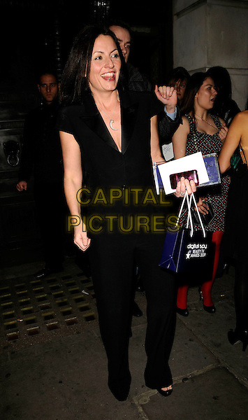 DAVINA McCALL .Digital Spy Reality TV Awards at the Bloomsbury Ballroom, London, England.  .April 6th, 2009.full length black trousers top sleeveless goody bag .CAP/CAN.©Can Nguyen/Capital Pictures.