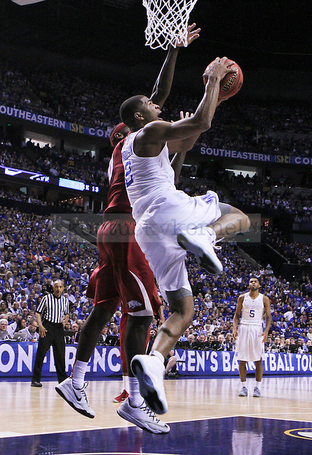 Kentucky guard Aaron Harrison tries to lay the ball in during the second half of the Championship game of the SEC tournament against Arkansas in Nashville , Tenn., on Sunday, March 15, 2015. Photo by Jonathan Krueger | Staff
