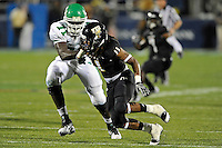 1 September 2011:  FIU defensive end Denzell Perine (11) gets around North Texas offensive lineman Antonio Johnson (71) in the second half as the FIU Golden Panthers defeated the University of North Texas, 41-16, at FIU Stadium in Miami, Florida.