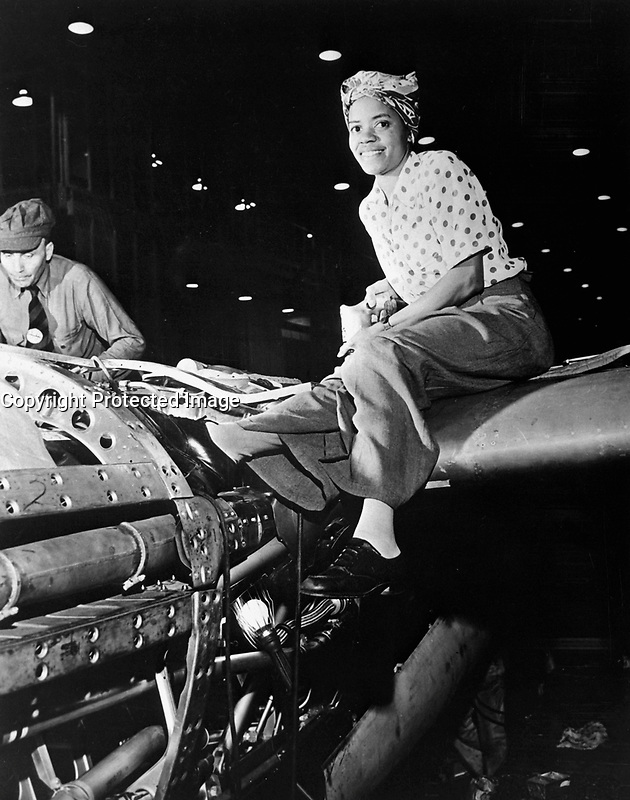 Riveter at Lockheed Aircraft Corp., Burbank, CA. (Women's Bureau)<br /> Exact Date Shot Unknown<br /> NARA FILE #:  086-WWT-3-67<br /> WAR &amp; CONFLICT BOOK #:  804