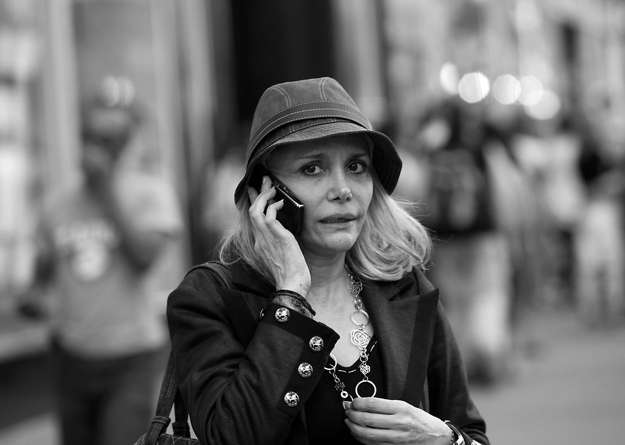 New Yorkers make phone calls on mobile phones as they walk in Manhattan.