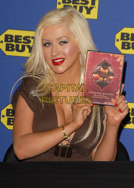 CHRISTINA AGUILERA.at her instore appearance in support of Back to Basics Live & Down Under Concert DVD held at Best Buy in West Hollywood, California, USA,  February 05 2008..half length red liptick cleavage gold necklace hoop earrings leopard print bra sitting.CAP/DVS.?Debbie VanStory/Capital Pictures
