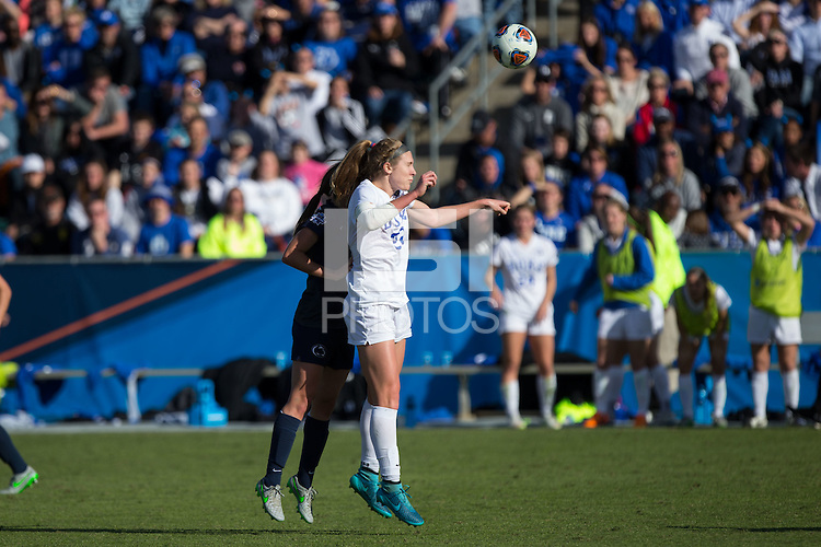 Cary, North Carolina - Sunday December 6, 2015: Malinda Allen (22) of the Duke Blue Devils battles for a jump ball with Kaleigh Riehl (3) of the Penn State Nittany Lions during second half action at the 2015 NCAA Women's College Cup at WakeMed Soccer Park.  The Nittany Lions defeated the Blue Devils 1-0.