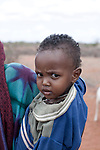 MATHAHALIBAH, KENYA - JULY 4: Mohammedek Siyad, 21 months old, is carried home by his grandmother after visiting a Save the Children outreach site in the location on July 4, 2011 in Mathahalibah, Kenya. The team examined about thirty children, among them several severely malnourished. Mohammedek's grandmother Habiba Sahal came with him to the outreach site to receive some food and medicine. His mother left three months ago with their remaining livestock. Forced away due to the sever drought in the area. She is expected back when rain falls again. Mohammedek is now being cared by his grandmother. Two successive poor rains, entrenched poverty and lack of investment in affected areas have pushed millions of people into a fight for survival in the Horn of Africa. This is the driest this area have been since sixty years. (Photo by Per-Anders Pettersson)