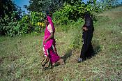 Rekha RAMESH is seen with her son, Prahlad RAMESH as she walks behind her mother, Baijabai Badri through their fields in Dhawati VIllage of Khaknar block of Burhanpur district in Madhya Pradesh, India.  Photo: Sanjit Das/Panos for ACF