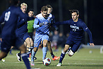 CARY, NC - NOVEMBER 19: North Carolina's Alan Winn (18) and UNCW's Hjalmar Ekdal (SWE) (12). The University of North Carolina Tar Heels hosted the UNCW Seahawks on November 19, 2017 at Koka Booth Stadium in Cary, NC in an NCAA Division I Men's Soccer Tournament Second Round game. UNC won the game 2-1.