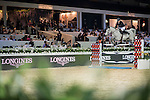 Roger-Yves Bost of France riding Pegase du Murier competes during the Longines Grand Prix, part of the Longines Masters of Hong Kong on 12 February 2017 at the Asia World Expo in Hong Kong, China. Photo by Victor Fraile / Power Sport Images
