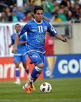 El Salvador's Rodolfo Zelaya dribbles the ball.  El Salvador defeated Cuba 6-1 at the 2011 CONCACAF Gold Cup at Soldier Field in Chicago, IL on June 12, 2011.