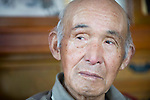 Minoru Oka, 85, speaks during an interview at his home in Minamisoma, Fukushima Prefecture, Japan on Friday 05 August, 2011.  For Oka the nuclear crisis that began almost 5 months ago just down the road from his home  following the March 11 quake and tsunami is his second brush with the threat of radiation. .When the atomic bomb was dropped on Hiroshima on Aug. 6, 1945, Oka was a 19-year-old member of an Imperial Japanese Army unit located in Hiroshima..Photographer: Robert Gilhooly