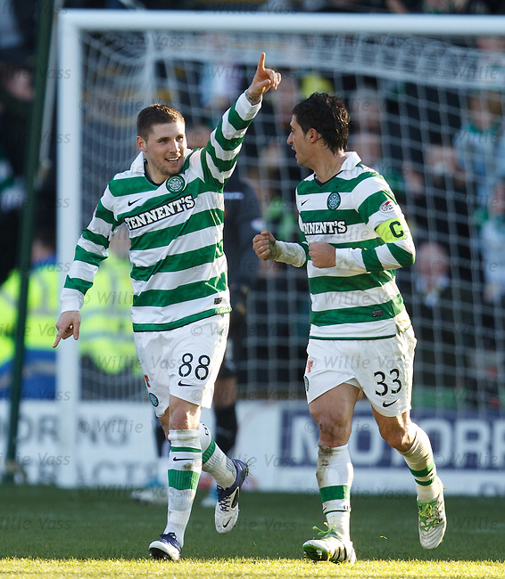 Gary Hoopecelebrates his goal and gestures to Neil Lennon in the Celtic dugout