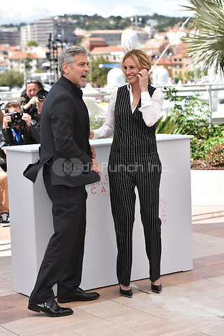 George Clooney and Julia Roberts at 'Money Men' photocell during the 69th International Cannes Film Festival, France<br /> May 12, 2016<br /> CAP/PL<br /> &copy;Phil Loftus/Capital Pictures /MediaPunch ***NORTH AMERICA AND SOUTH AMERICA ONLY***