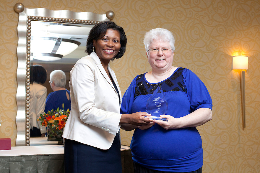 April Hawkins gives Ruth Dodds her award at the Older Volunteers Enrich America Awards at the Double Tree Hotel in Washington, DC on Friday, June 17, 2011.