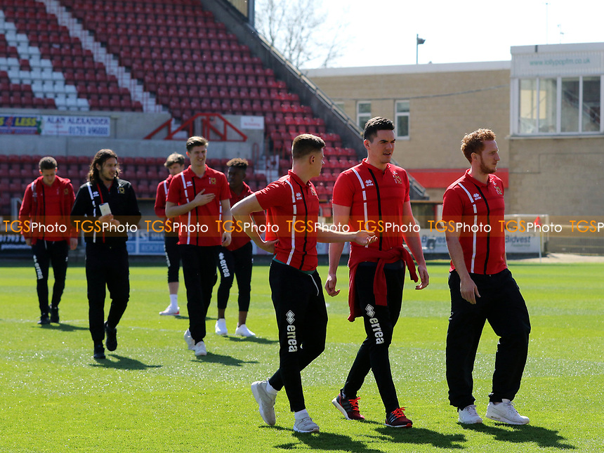 MK Dons players walk onto the pitch pre-match during Swindon Town vs MK Dons, Sky Bet EFL League 1 Football at the County Ground on 8th April 2017