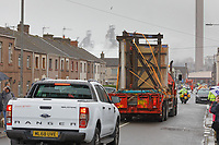 Pictured: The Banksy is transported through Dyffryn Road on a flat bed lorry. Wednesday 29 May 2019<br /> Re: Contractors are working to move Banksy's Season Greeting, now owned by John Brandler, which appeared on a garage wall in Port Talbot, to a new location in the same town in south Wales, UK.