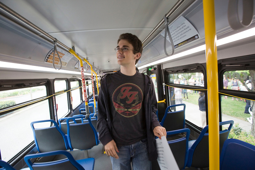 Jaden Lindsey, an 8th grader at the Vancouver School of Arts & Academics looks for a poem he wrote in a bus in downtown Vancouver Sunday July 3, 2016. The C-Trans program, Poetry Moves features poems written by school kids, displayed in busses. (Photo by Natalie Behring/ The Columbian)