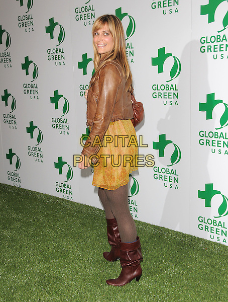 MOLLY SIMS.The 5th Annual Global Green USA Pre-Oscar Party highlighting Global Warming Solutions held at Avalon in Hollywood, California, USA..February 20th, 2008.full length simms yellow green dress brown leather jacket boots tights pattern looking over shoulder .CAP/DVS.©Debbie VanStory/Capital Pictures.