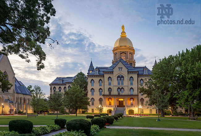 July 12, 2017; Main Building at dusk (Photo by Matt Cashore/University of Notre Dame)