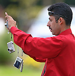 A limo driver takes many different photographs with an array of different point and shoot cameras for his clients in Napa Valley, California.