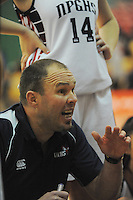 NPGHS coach Trent Adam talks to his team during the 2014 National Secondary Schools Basketball Championship AA girls' semifinal between New Plymouth Girls' High School and St Peter's College Cambridge at Arena Manawatu, Palmerston North, New Zealand on Friday, 3 October 2014. Photo: Dave Lintott / lintottphoto.co.nz