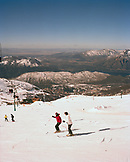 ARGENTINA, Bariloche, Cerro Cathedral, people skiing on snow capped mountain