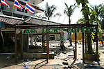 A security guard keeps watch over the gutted Starbucks coffee shop the day after a tsunami hit Patong Beach on Phuket Island, Thailand. On December 26, 2004, a major earthquake generated tsunamis that ravaged coastlines from Southeast Asia to Africa. Approximately 275,000 people were killed and tens of thousands were left homeless, making it one of the deadliest natural disasters in modern history.