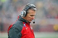Ohio State Buckeyes head coach Urban Meyer against Minnesota Golden Gophers defense during the 1st quarter at TCF Bank Stadium in Minneapolis, Minn. on November 15, 2014.  (Dispatch photo by Kyle Robertson)