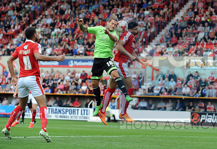 Billy Sharp of Sheffield United is challenged by Raphael Rossi Branco of Swindon Town<br /> - English League One - Swindon Town vs Sheffield Utd - County Ground Stadium - Swindon - England - 29th August 2015