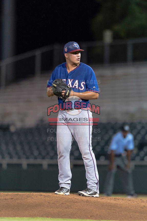 AZL Rangers relief pitcher Tyler Cohen (55) gets ready to deliver a pitch during an Arizona League game against the AZL Giants Black at Scottsdale Stadium on August 4, 2018 in Scottsdale, Arizona. The AZL Giants Black defeated the AZL Rangers by a score of 6-3 in the second game of a doubleheader. (Zachary Lucy/Four Seam Images)