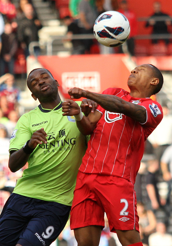 Aston Villa's Darren Bent and Southampton's Nathaniel Clyne come together...Football - Barclays Premiership - Southampton v Aston Villa - Saturday 22nd September 2012 - St Mary's Stadium - Southampton..