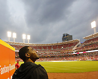 Ohio State quarterback Braxton Miller looks at the rain coming down delaying the start of the Reds/Pirates game at Great American Ball Park on Wednesday April 8, 2015. (Dispatch photo by Jonathan Quilter)