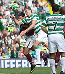 Chris Killen heads in past the challenge of Lee Wallace to score for Celtic
