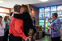 "Maryellen Rogers (in black), of Scituate, embraces musician Duane Sullivan, of Belmont, Mass., after the final service at St. Frances Xavier Cabrini Church in Scituate, Mass., on Sun., May 29, 2016. Rogers has served as a spokesperson for the congregation during the vigil. Sullivan has performed music during services at the church for about 4 years.  Members of the congregation have been holding a vigil for more than 11 years after the Archdiocese of Boston ordered the parish closed in 2004. For 4234 days, at least one member of Friends of St. Frances X. Cabrini has been at the church at all times, preventing the closure of the church. May 29, 2016, was the last service held at the church after members finally agreed to leave the building after the US Supreme Court decided not to hear their appeal to earlier an Massachusetts court ruling stating that they must leave. The last service was called a ""transitional mass"" and was the first sanctioned mass performed at the church since the vigil began."