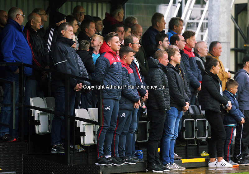 Pictured: Fans observe a minute's silence in tribute to honorary president Gwilym Joseph. Friday 11 August 2017<br /> Re: Premier League 2, Division 1, Swansea City U23 v Liverpool U23 at the Landore Training Ground, Swansea, UK