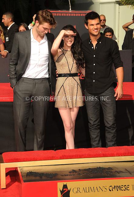 WWW.ACEPIXS.COM ************....November 3 2011, LA....Actors Robert Pattinson, Kristen Stewart and Taylor Lautner at 'The Twilight Trio' Hand/Footprint Ceremony at Grauman's Chinese Theatre on November 3, 2011 in Hollywood, California......Please byline: PETER WEST -- ACEPIXS.COM.. *** ***  ..Ace Pictures, Inc:  ..tel: (646) 769 0430..e-mail: info@acepixs.com..web: http://www.acepixs.com