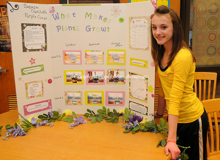 TERRYVILLE, CT-31 MARCH 2010-033110IP03-    Seneca Ouellette, a seventh grade student at Eli Terry Jr. Middle School in Terryville created a project on the effects of water, orange juice and Gatorade on the growth of plants and had it on display during the school's third annual science fair on Wednesday. <br /> Irena Pastorello Republican-American