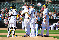 Sept. 12, 2010 - Oakland California, U.S. - Oakland Athletics pitcher Dallas Braden, center, is joined on the mound by teammates after giving up two runs against the Boston Red Sox at the Oakland Coliseum Saturday Sept. 12,  2010. The Red Sox won the Game 5-3. (Photo by Alan Greth)