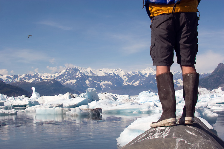 Alaska, Prince William Sound, Lone sea kayaker standing on glacial erratic, Columbia Bay, Columbia Glacier, pack ice, USA, North America, David Fox, released,.