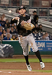Sacramento River Cats third baseman Wes Timmons make the throw to first during their play off game agianst the Reno Aces on Saturday night September 8, 2012 at Aces Ballpark in Reno NV.