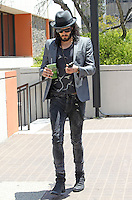 Cleansing? Russell Brand seen with a healthy green juice from the EarthBar and a friend leaving an immigration building in Downtown Los Angeles, California on 21.05.2012..Credit: Correa/face to face.. /MediaPunch Inc. ***FOR USA ONLY***