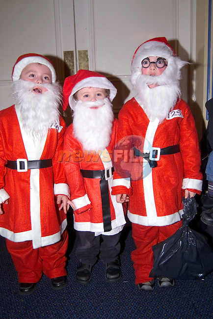 Conor Moran, Conor Farrel, & Ian Connor the 3 Santas at the Fit Teen Christmas party in the Europa Hotel...Picture Fran Caffrey Newsfile.